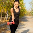 Woman working out with weights — Stock Photo #13406489
