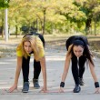 Stock Photo: Teammates training for a running competition