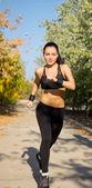 Sportlerin, jogging — Stockfoto