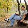 Man relaxing with a book — Stock Photo