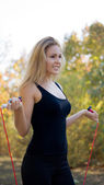 Shapely woman with skipping rope — Stock Photo