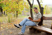Man enjoying a book in the garden — Stock Photo