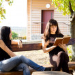 Two women siting on bench — Stock Photo