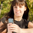 Woman holding mobile phone — Stock Photo #13613930