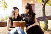 Two women reading together — Stock Photo
