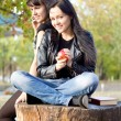 Stock Photo: Young woman eating an apple