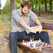 Royalty-Free Stock Photo: Man stretching while playing chess