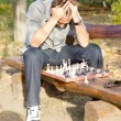 Chess player in despair — Stock Photo #13658247