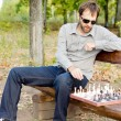 Man planning his next chess move — Stock Photo #13658254