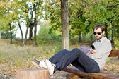 Man reading a message on his mobile — Stock Photo