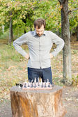 Man planning his chess strategy — Stock Photo