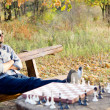 Man relaxing waiting for a chess opponent — Stock Photo