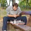 Chess player planning his strategy - Stock Photo