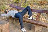 Man asleep on a wooden bench — Stock Photo