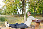 Young man relaxing in the sun — Foto Stock