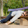 Exhausted man sleeping on bench - Stock Photo