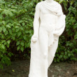 Classical statue in a garden — Stock Photo