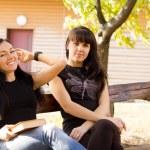 Young women relaxing outdoors — Stock Photo