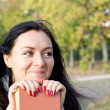 Smiling woman with a book — Stok fotoğraf