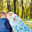 Brother and sister sharing secrets — Stock Photo