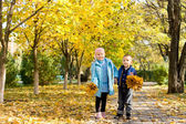 Brother and sister in autumn park — Stock Photo