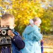 Little boy playing with a retro camera — Stock Photo