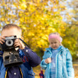 Little boy playing with a vintage slr camera — Stock Photo