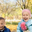 Happy children picking flowers — Stock Photo
