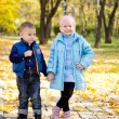 Stock Photo: Children posing in an autumn park