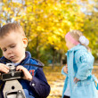 Young Boy Playing with Vintage Camera — Stock Photo