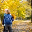 Stock Photo: Young Boy and Girl with Yellow Autumn Leaves