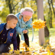 Beautiful Children Collecting Autumn Leaves — Stock Photo