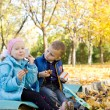 Children Having a Snack in Autumn Setting — Stock Photo