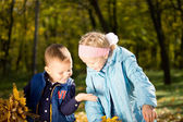 Two Children in Beautiful Autumn Woodland — Stock Photo