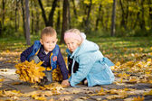 Young Children Playing Together in Autumn Woodland — Stock Photo