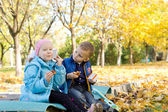 Children Having a Snack in Autumn Setting — Stock Photo