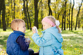 Children Having a Snack in a Lush Green Woodland — Stock Photo