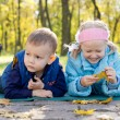 Small Children Relaxing in a Park in Autumn — Stock Photo