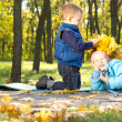 Little boy making a crown of leaves — Stock Photo #14061071