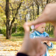 Stock Photo: Little girl seen through finger frame