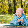 Young Girl in a Park Yawning — Stock Photo