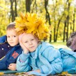 Young Children with a Hat Made of Leaves — Stock Photo