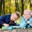 Happy Young Children Relaxing in a Park — Stock Photo