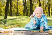 Laughing little girl pointing at the camera — Stock Photo