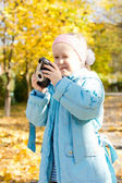 Aspiring young girl photographer — Stock Photo