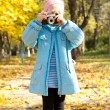 Little girl with a vintage camera — Stock Photo #14073693