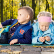 Two Young Children Relaxing in a Park — Stock Photo #14073718