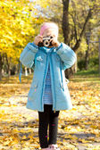 Little girl with a vintage camera — Stock Photo