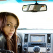 Woman driver looking into the rear seat — Stock Photo