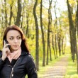 Woman waiting for a call on her mobile — Stock Photo
